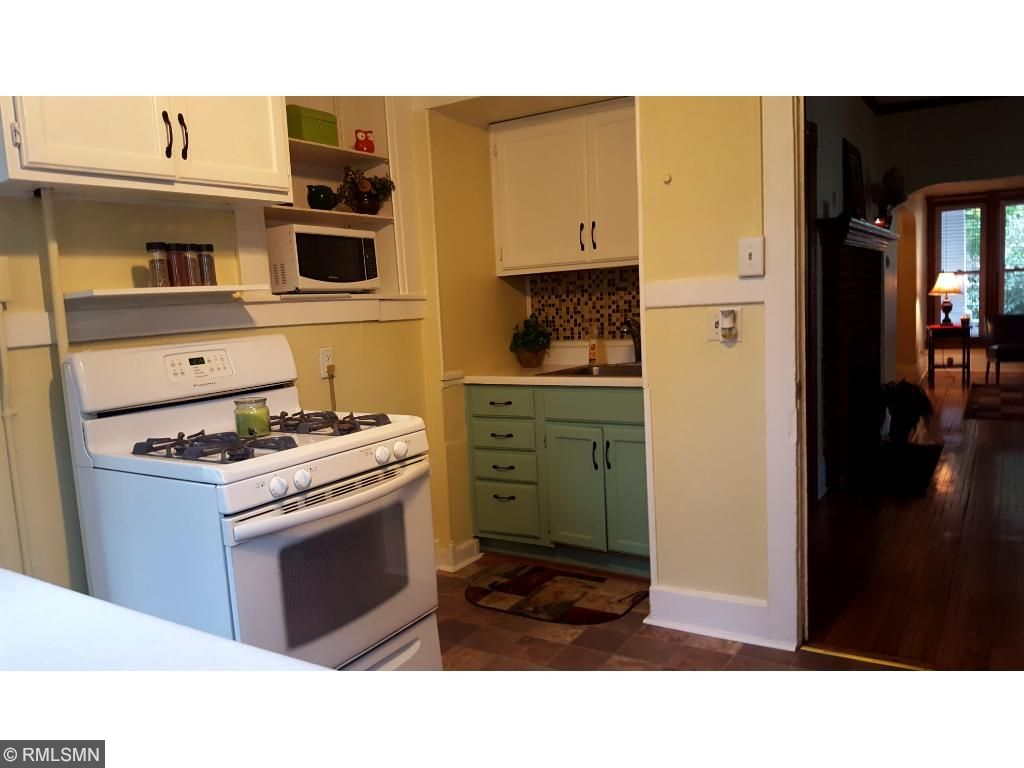 Updated kitchen with gas stove PLUS a Main Floor Update 3/4 Guest Bathroom with high ceilings and shelving.