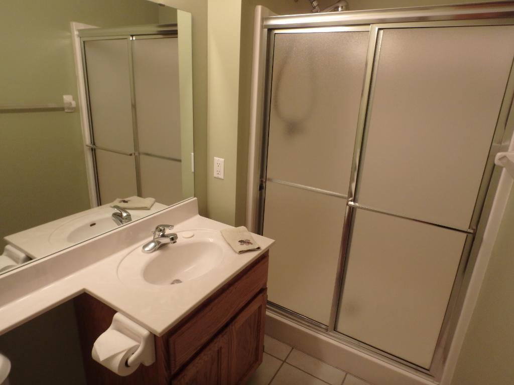 3/4 bath with tile floors