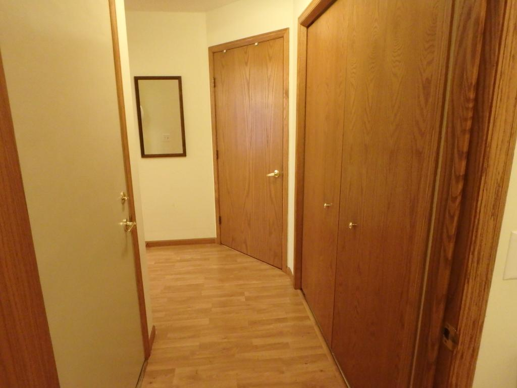Back hallway with garage entrance, laundry room, large closet and mechanical room