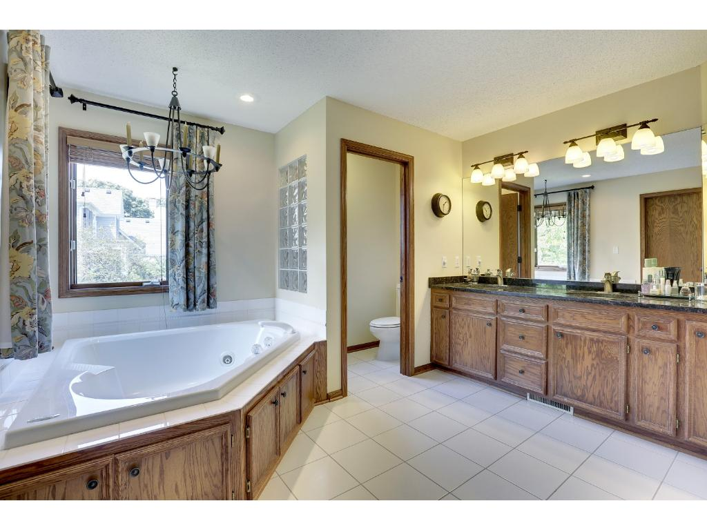 Owner's ensuite complete with a double sink and granite vanity