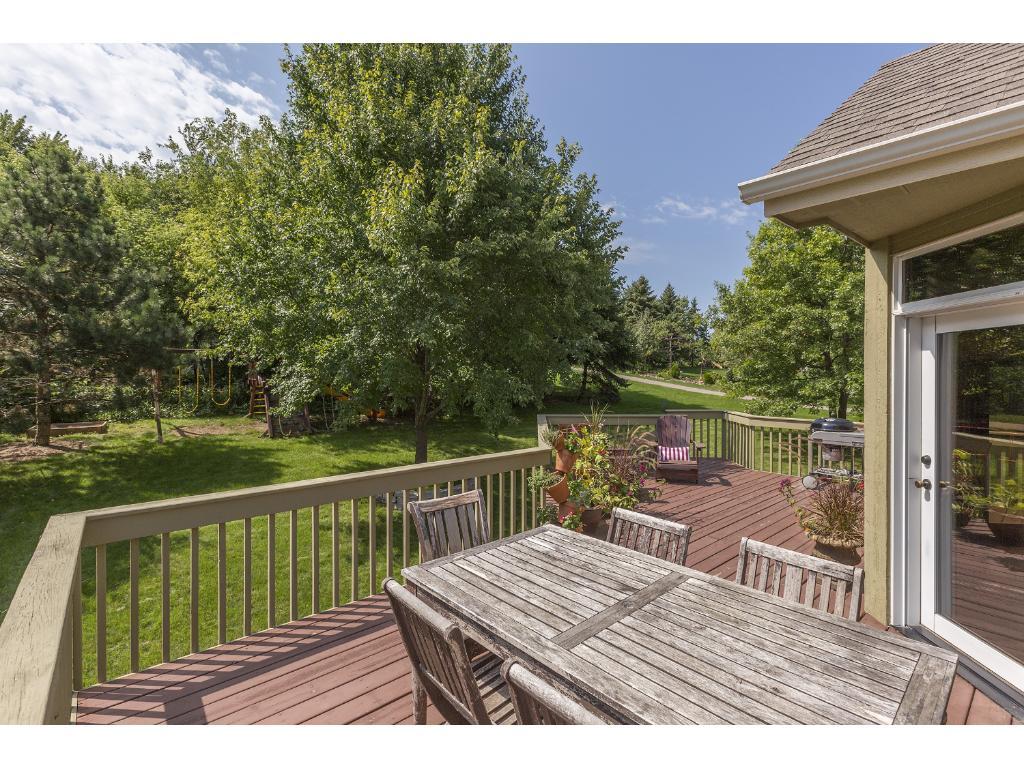 Mature trees surround this open backyard