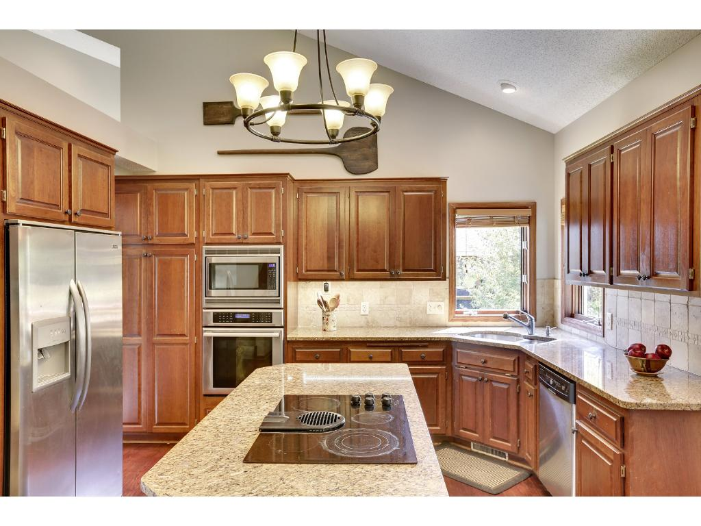 Updated kitchen with stainless steel appliance and granite counter