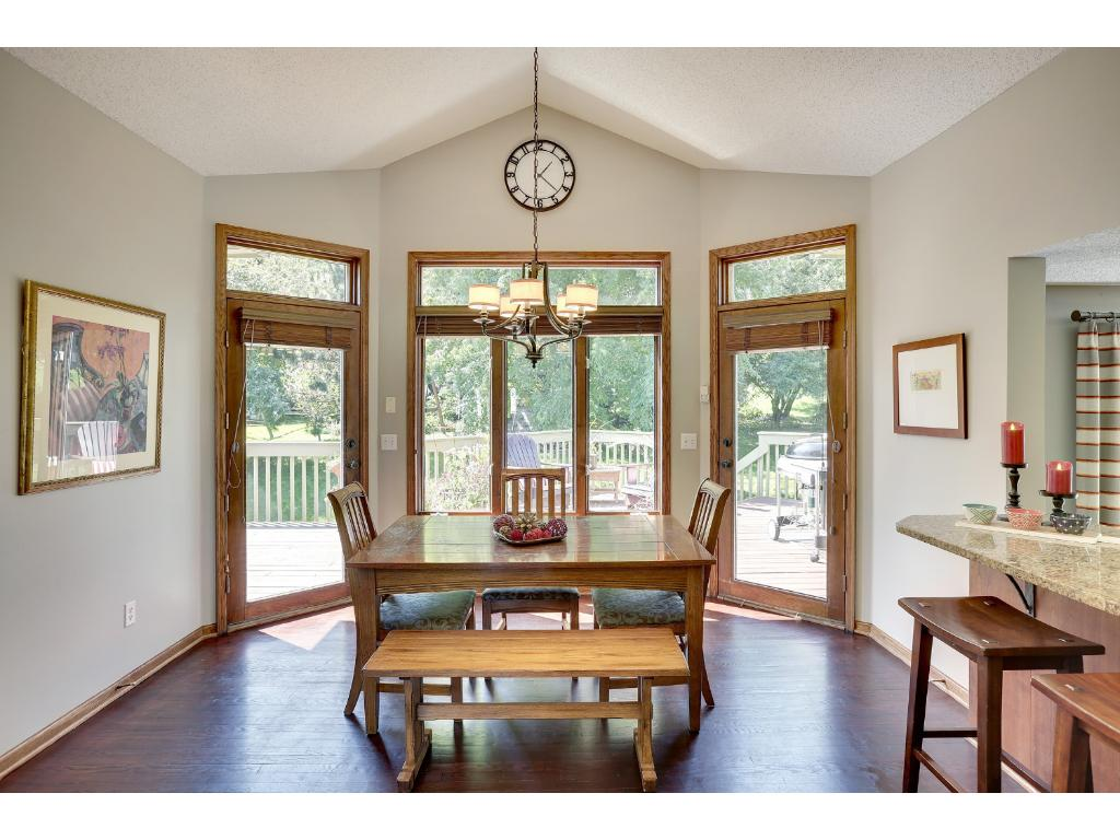 Spacious informal dining room with great views of the wooded backyard