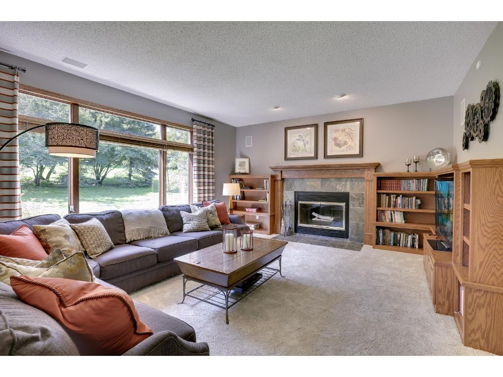 Family room with beautiful built-in entertainment center and wood burning fireplace