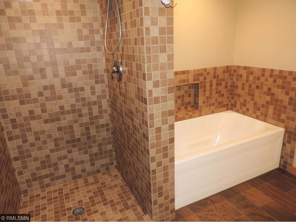 Gorgeous remodeled bathroom with walk-in shower and tub with beautiful vanity.