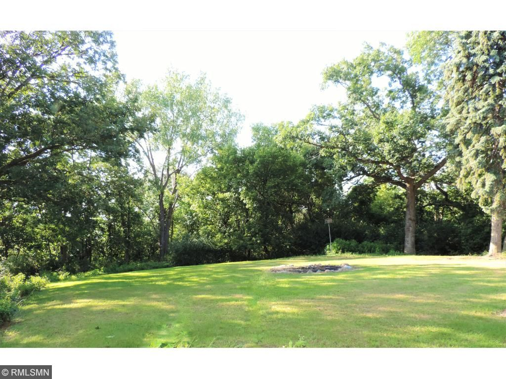 Private backyard with firepit and wooded lot on cul-de-sac.