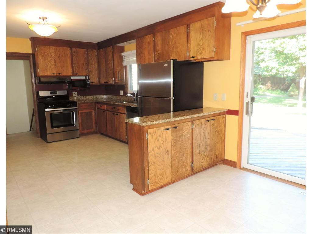 Spacious kitchen with granite counters, tons of cabinets and pantry closet.