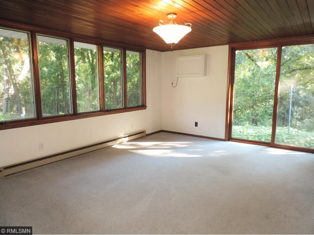 Formal dining room walks out to paver walkway.
