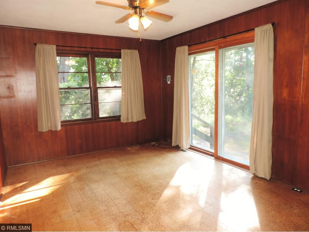 Main floor 2nd bedroom/office or sunroom walks out to private backyard.