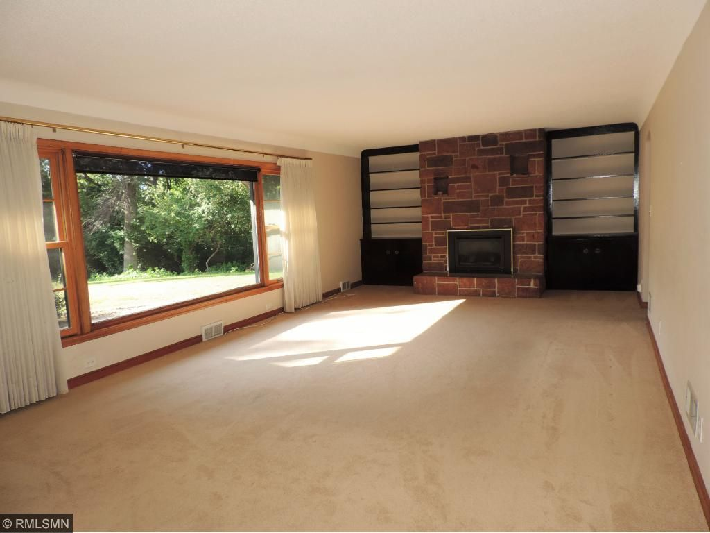Huge living room with built-ins and 1 of 2 fireplaces.