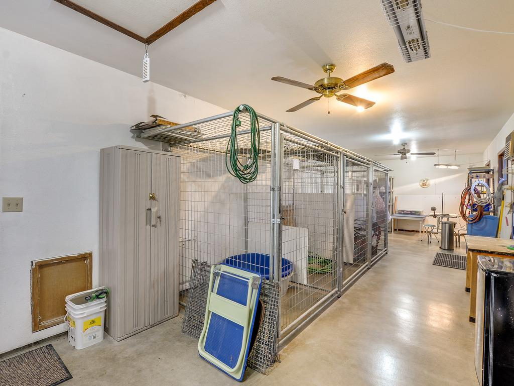 There is a 36' X 12' Room attached to the house that is currently a dog kennel with runs. It could be anything you'd like - Craft Room, Hobby Room, Shop, Home Business. Use your imagination.