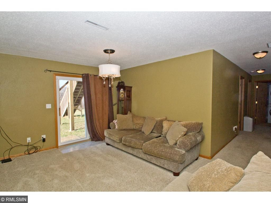 The family room in the lower level has a walkout, another fabulous light fixture, and plenty of space!
