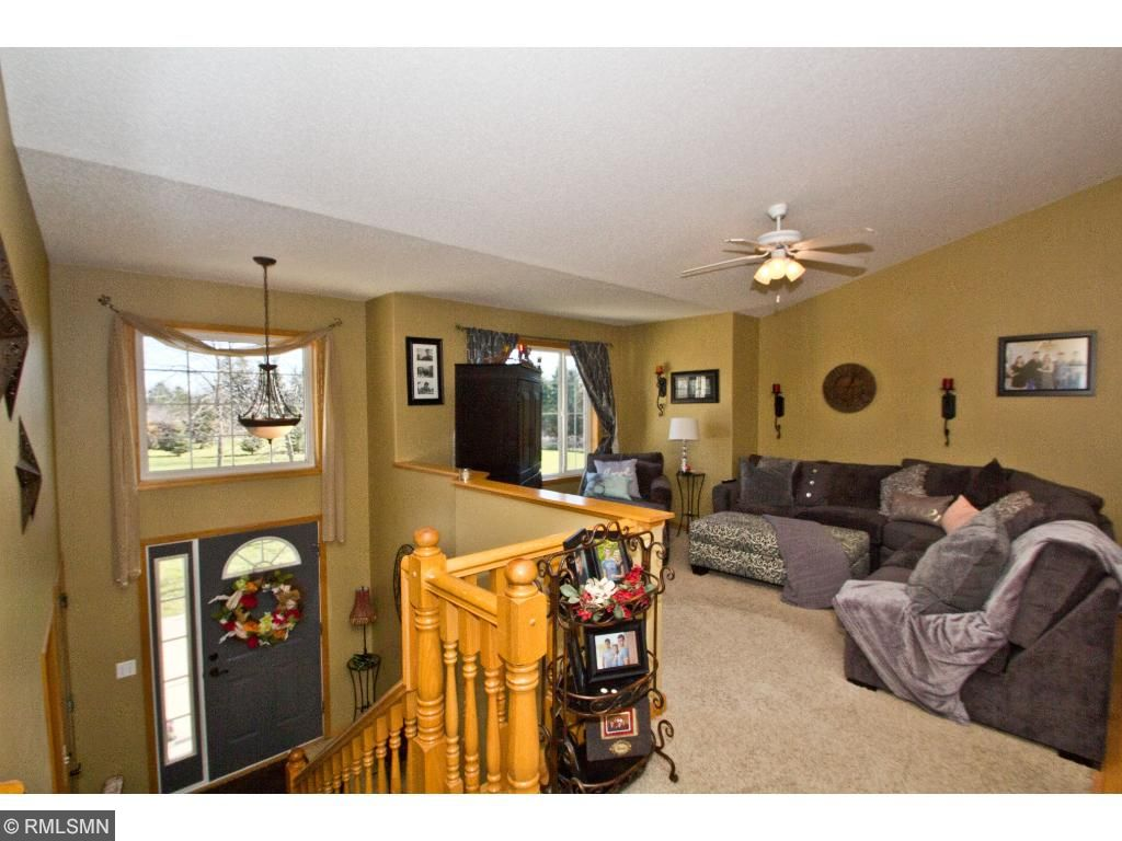 The upper level features a wonderful open layout with a spacious living room, gorgeous views out the windows, and plush carpeting.