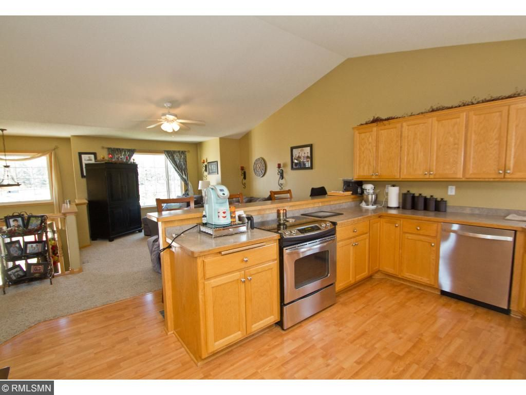 Open concept kitchen with a breakfast bar spanning the length of the counter is a wonderful gathering space!