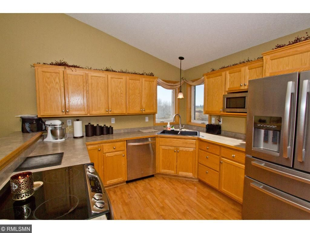 Kitchen is spacious with lots of storage throughout, stainless appliances, and great corner windows above the sink.