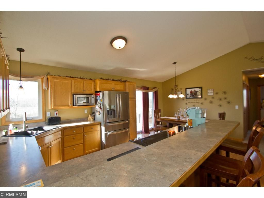 This breakfast bar - such wonderful space for gathering, eating, sharing your day - it all happens right here in the center of the living space!