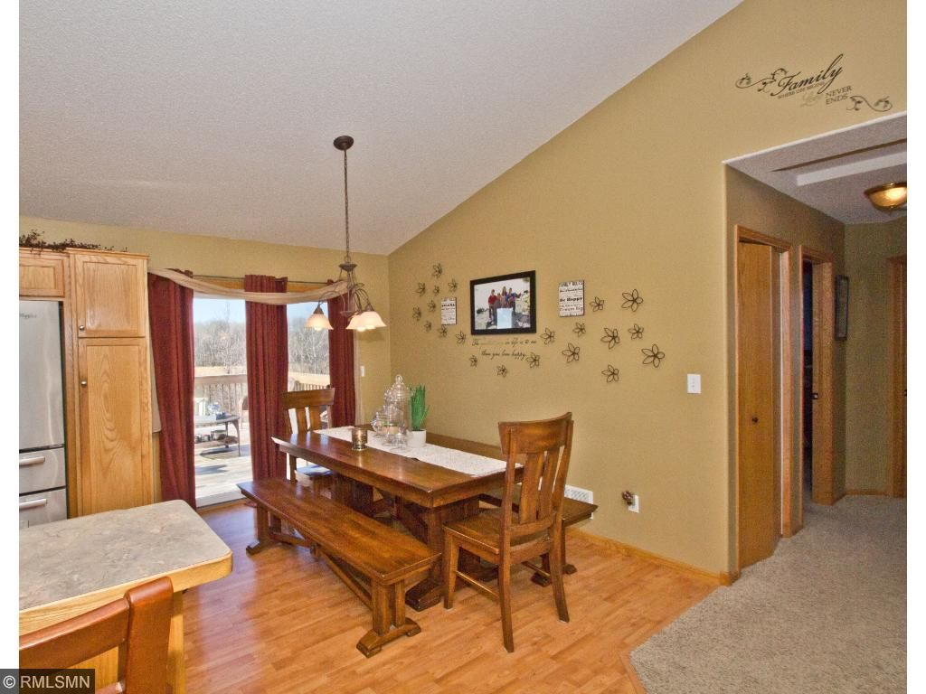 The dining room with a peek out onto the deck in the backyard.  Dinners and grilling never looked so good!