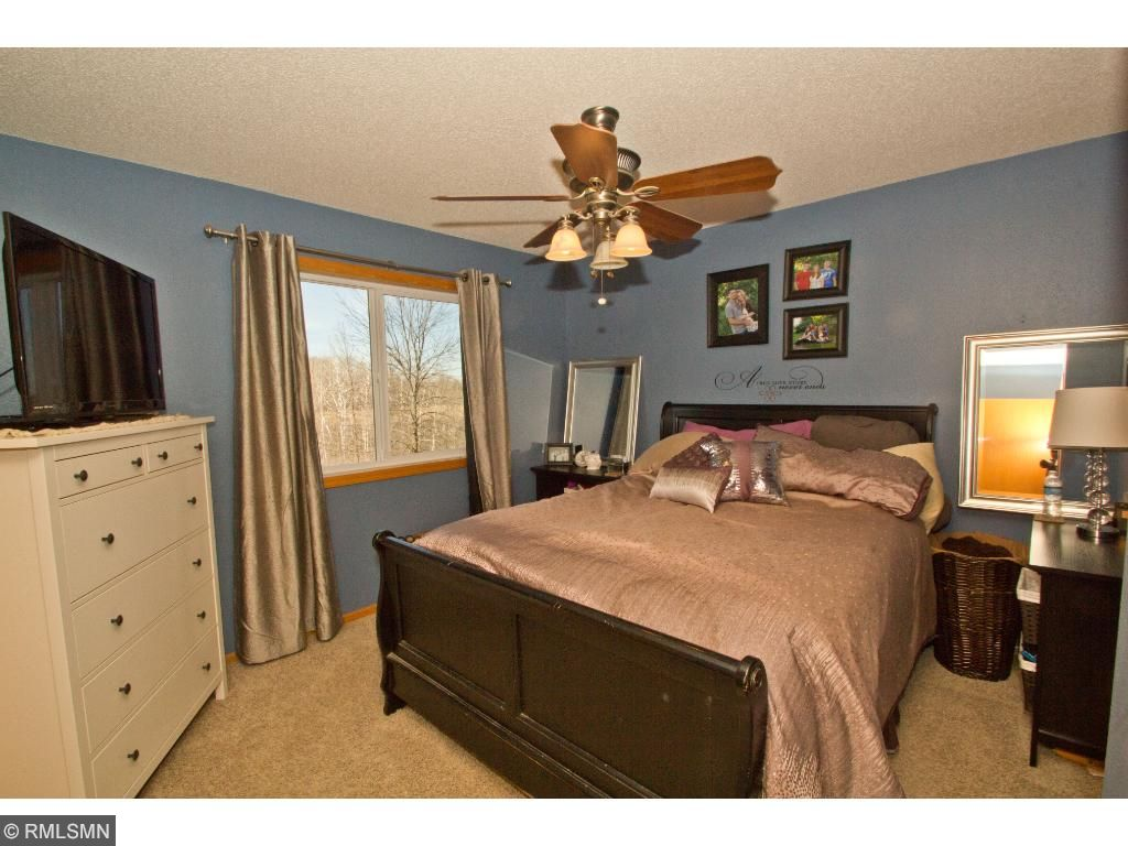 The master bedroom has a simply gorgeous view of your new 5 acres.