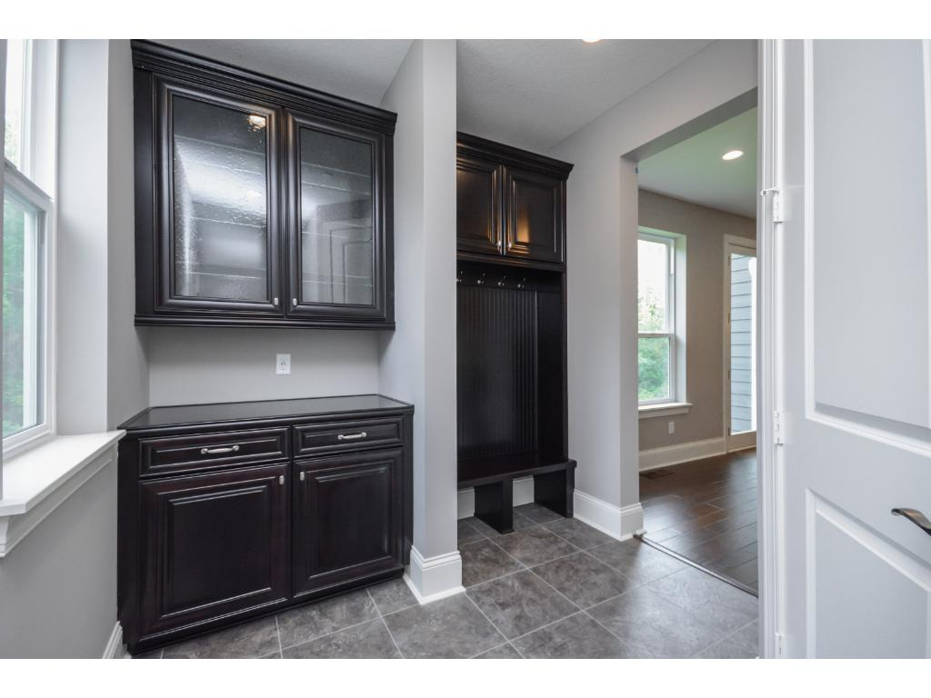 Drop zone in the spacious mudroom offers a smart space to keep organized.