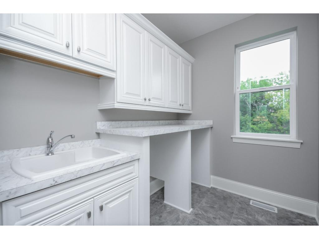 Dream laundry room, lots of space to organize.
