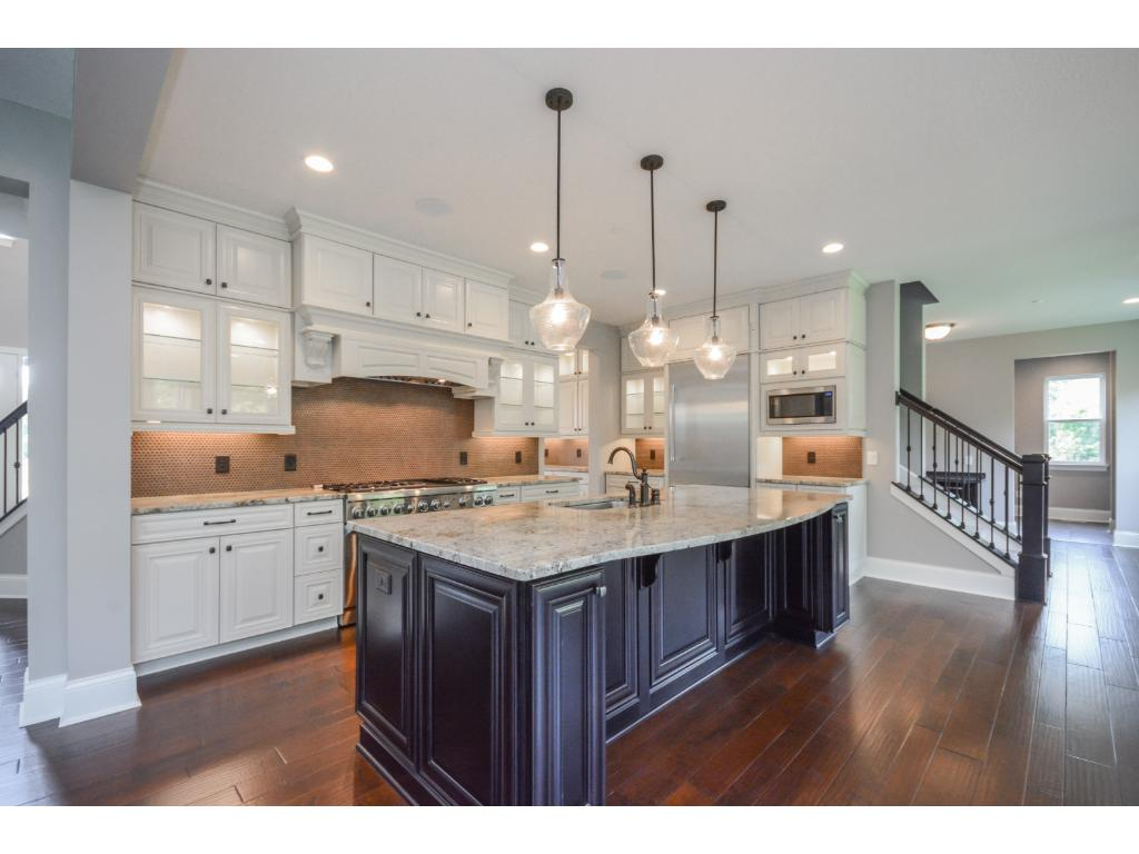 Cook in the beautiful kitchen featuring professional grade Thermador appliances.