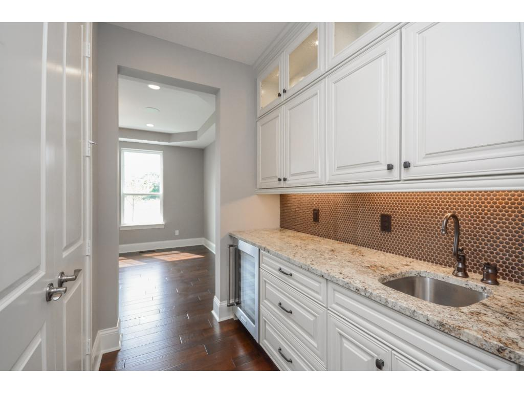 Butlers pantry between the Kitchen and Dining makes serving at parties a breeze.