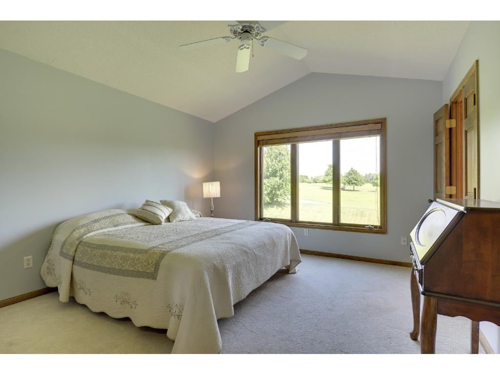 Master suite with walk-in closet and views of Deer Run...