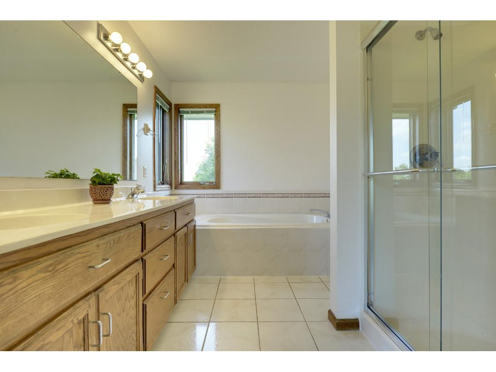 Master bath with tile and separate tub and shower...