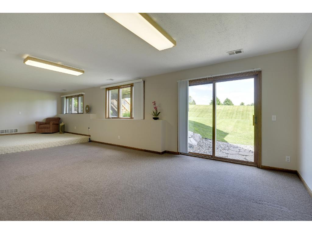 Wonderful walk-out family room with space for pool or game table...