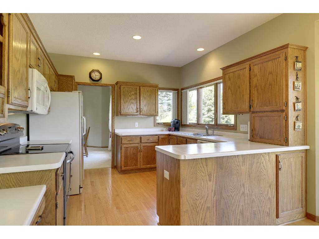 Spacious open and bright kitchen with views of golf course - ready for your creative updates...