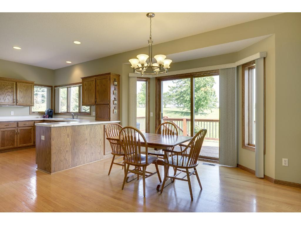 Enjoy informal dining while watching golfers or step out onto lovely deck for a better view...