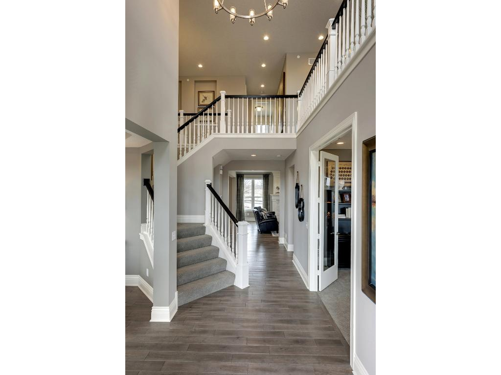 This Grand Entrance Meets You At The Door. 9 Foot Ceilings On The Main And