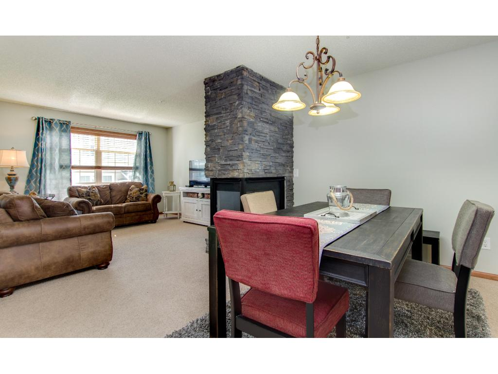 The open floor plan is inviting and perfect for entertaining. The owners have redone the gas fireplace with stacked rock, adding a nice touch to the living/dining areas.