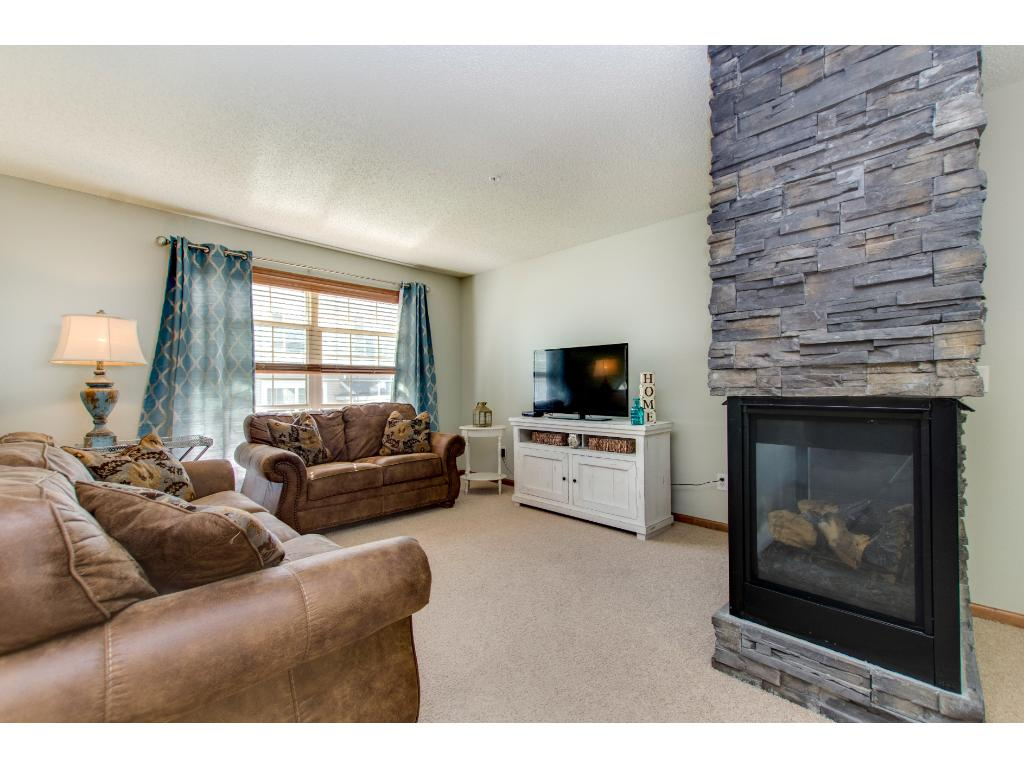The living room is bright and cozy with the large windows and the gas fireplace which is ready when ever you are!