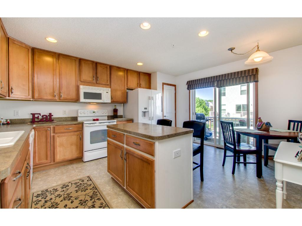 A great, open kitchen with a center island, pantry and  patio doors to deck.