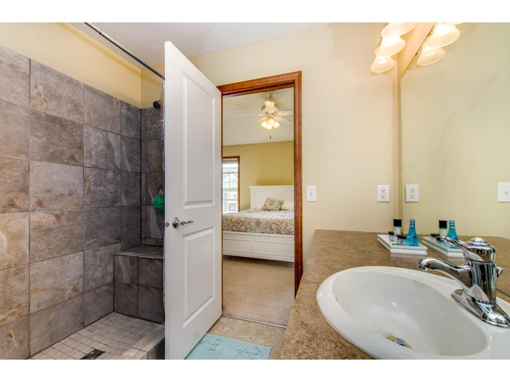 The upper level 3/4 bathroom is newly redone.  Walk through to the Owner Suite and additional bedroom.