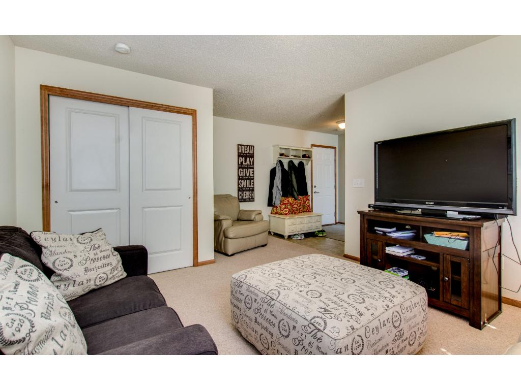 The entry from garage is roomy with a large closet.