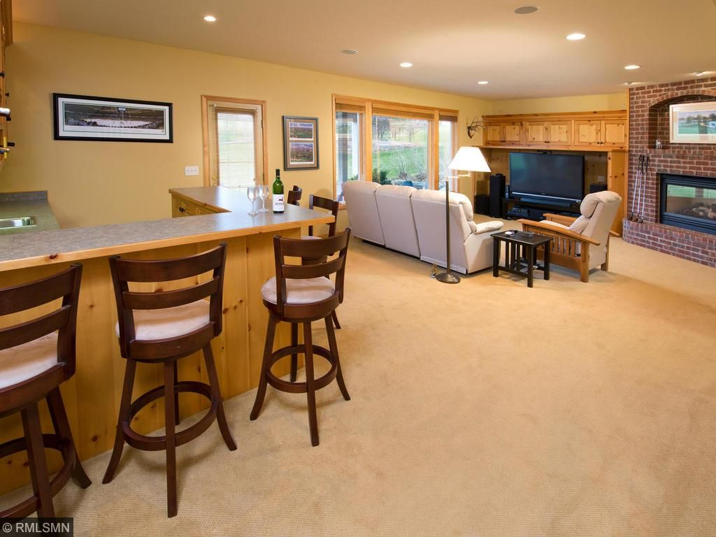 Full Walk Out Lower Level with wet bar, fireplace, exercise room, storage!