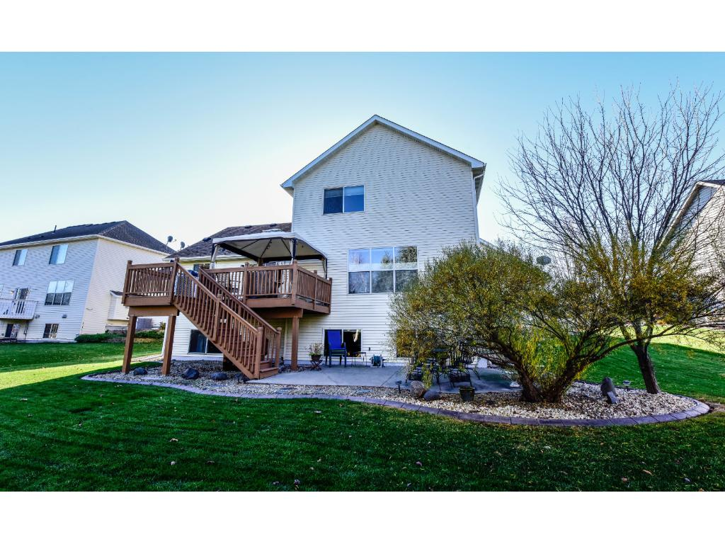 Yard is professionally landscaped, large deck and patio area are perfect place to relax.