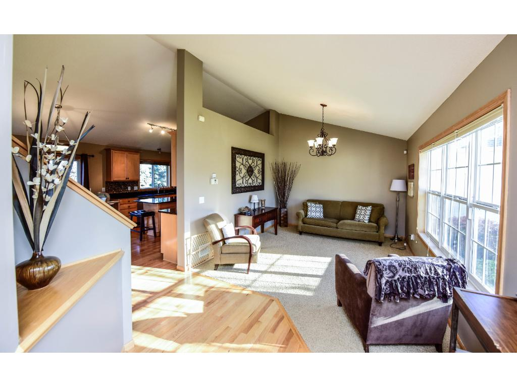 This main level is open and bright with vaulted ceilings and large picture windows.