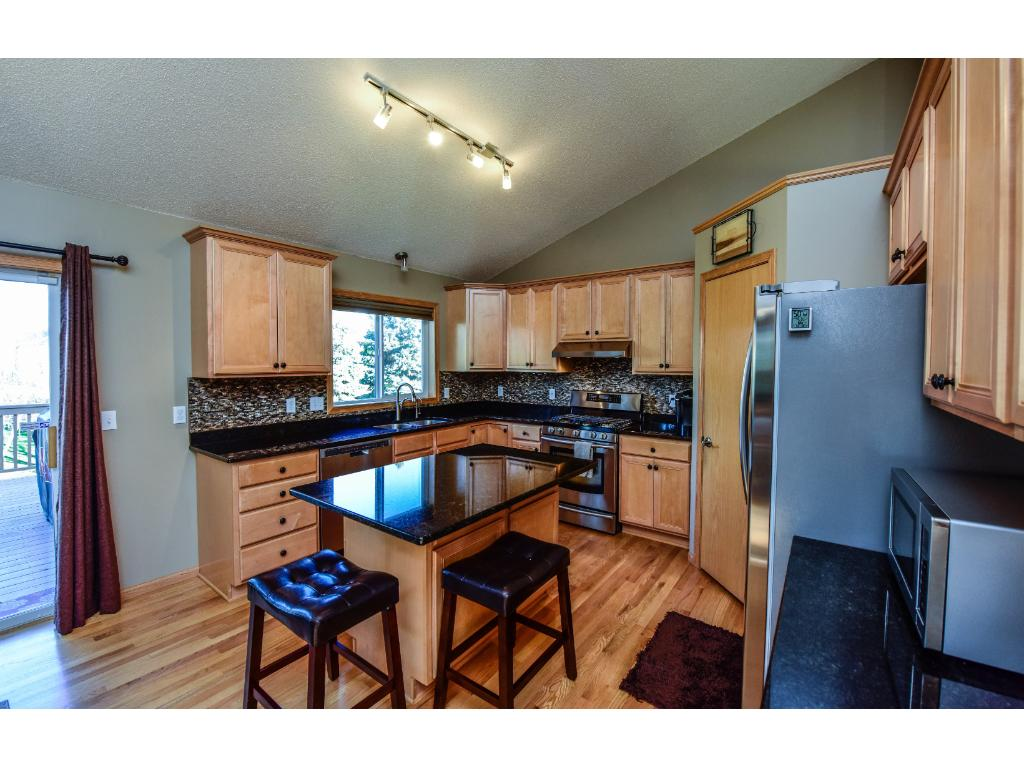 Granite counter tops, ss/appliances, and stone back splash.
