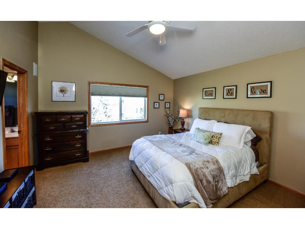 Large master suite with vaults, and ceiling fan.