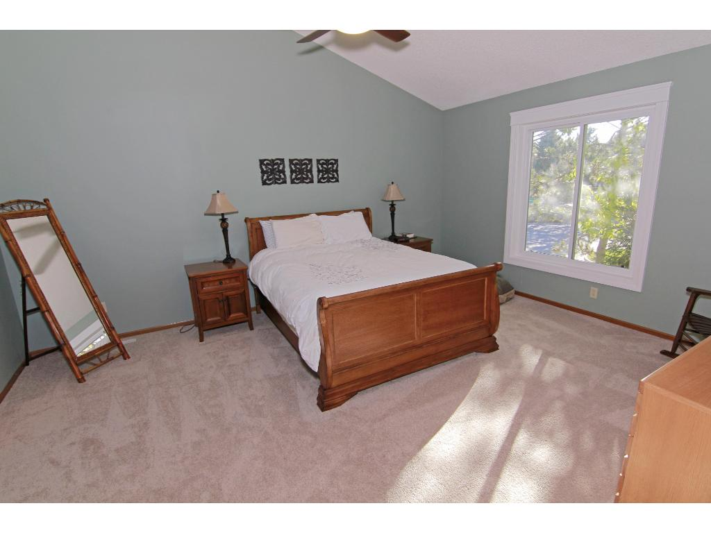 Huge master suite with vaulted ceilings, 2 walk-in closets and private bath.