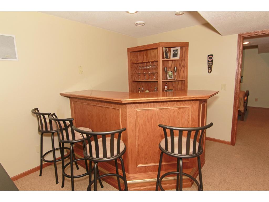 Great wet bar with refrigerator in the lower level amusement room.
