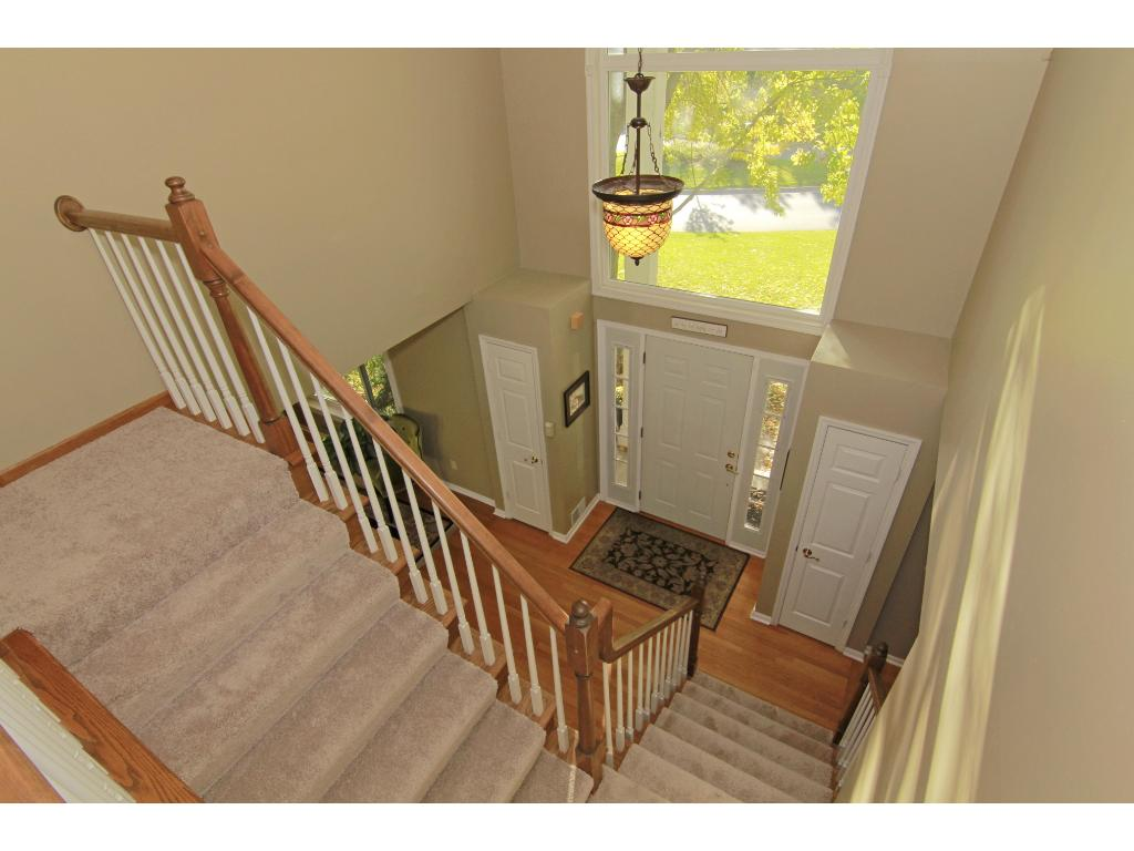Dramatic 2 story foyer with beautiful windows to let in natural light.