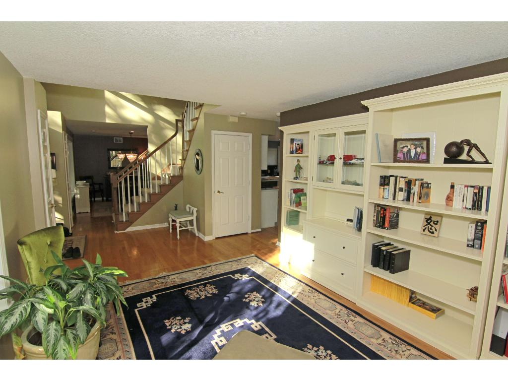 Welcoming living room, library or receiving area with gleaming hardwood flooring when guests arrive.