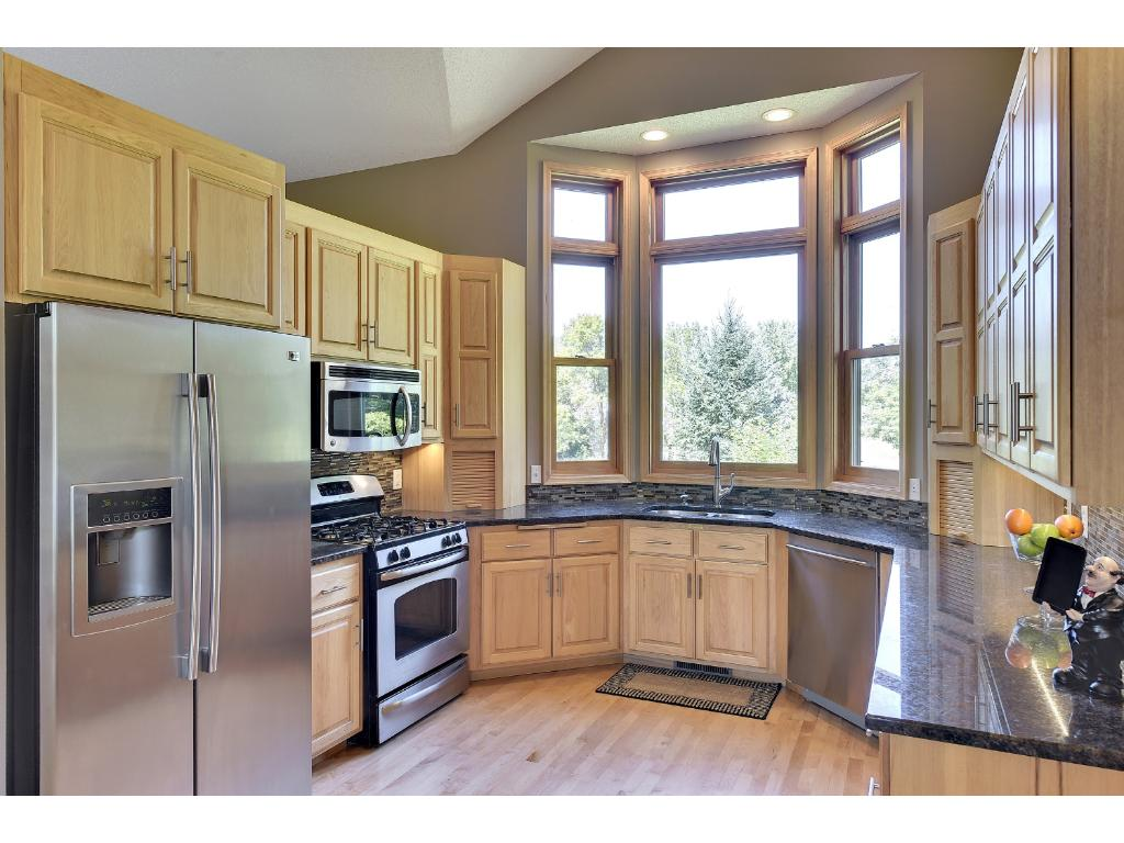 Superbe Style And Sophistication Await You In The Gourmet Kitchen With Upgraded SS  Appliances, Granite Countertops