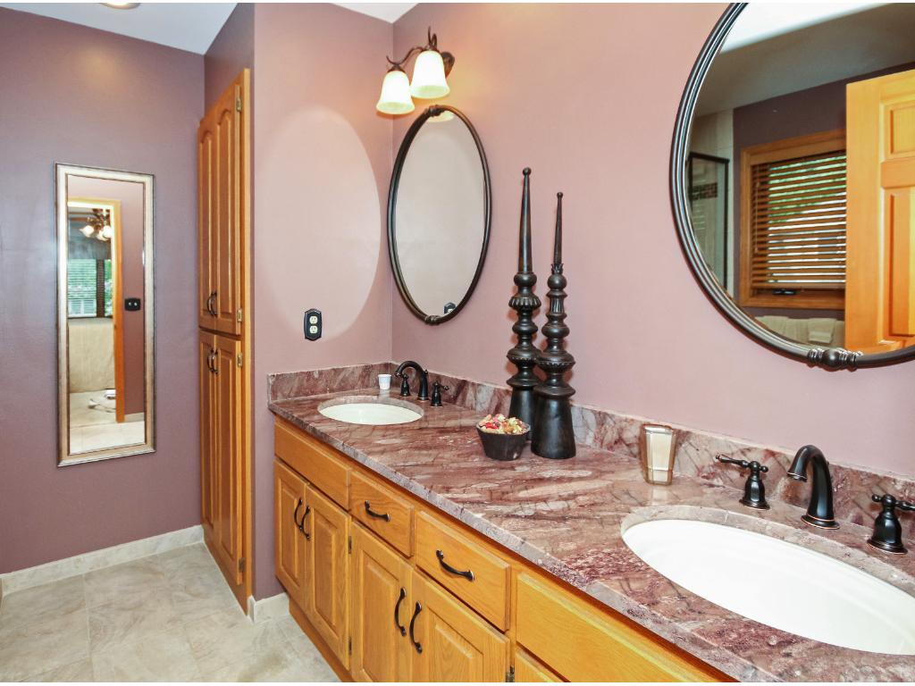 The master bath offers dual sinks and tiled floors.