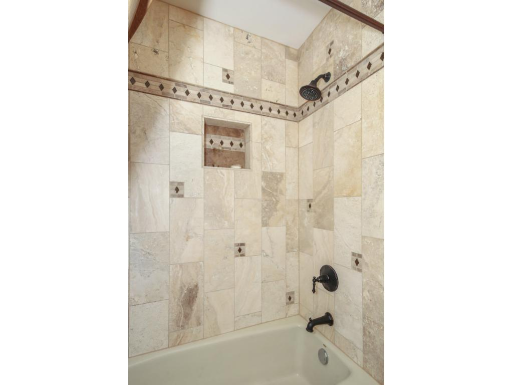 Another fully updated tile shower, these bathrooms were done right!