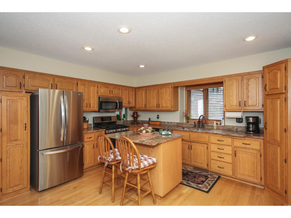 The large, sunny kitchen invites you to come in and create a delicious meal for the family to enjoy. Note the brand new LG stainless steel appliances.